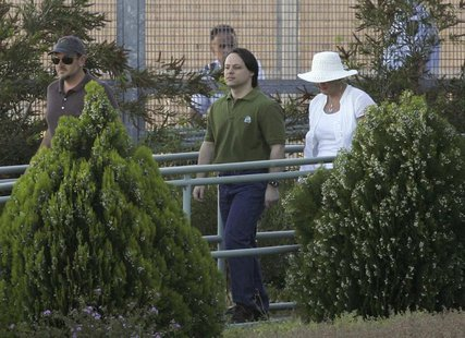 Former Guantanamo Bay detainee David Hicks (C) walks away from Yatala Prison with his former step mother Bronwyn Mewett in Adelaide December