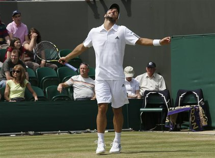 Viktor Troicki of Serbia reacts after losing advantage in his men's singles tennis match against Mikhail Youzhny of Russia at the Wimbledon