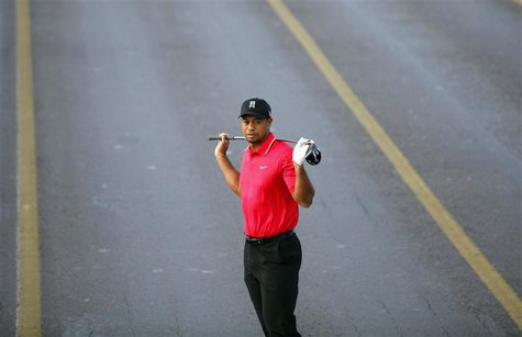 U.S. golfer Tiger Woods poses during an event to promote the upcoming Turkish Airlines Open golf tournament, on the Bosphorus Bridge that li