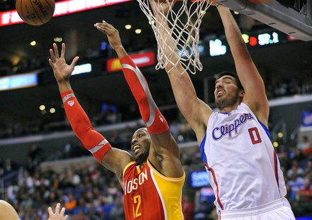 Los Angeles, CA, USA; Houston Rockets center Dwight Howard (12) and Los Angeles Clippers center Byron Mullens (0) play for the rebound durin