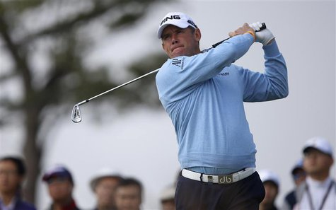 Lee Westwood of the U.S. tees off on the second hole during the BMW Masters 2013 golf tournament at Lake Malaren Golf Club in Shanghai Octob