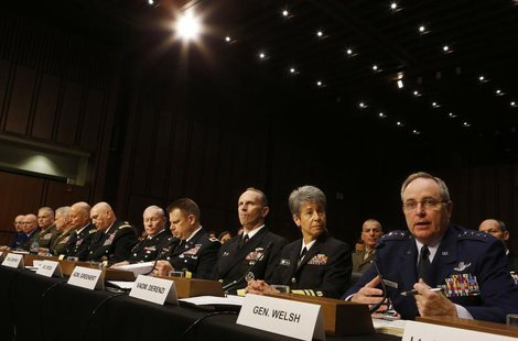 Air Force Chief of Staff Gen. Mark A. Welsh III (R) testifies about pending legislation regarding sexual assaults in the military at a Senat