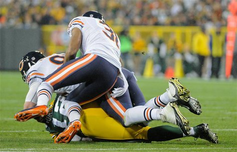 Green Bay, WI, USA; Chicago Bears defensive end Shea McClellin (99) and cornerback Isaiah Frey (31) sacks Green Bay Packers quarterback Aaro