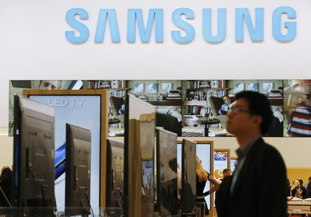 A journalist walks at the Samsung booth during a media preview day at the IFA consumer electronics fair in Berlin, September 5, 2013. REUTER