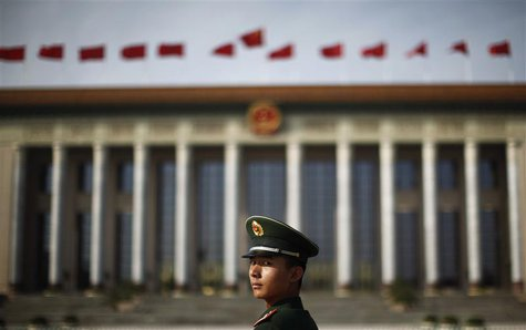 A paramilitary police officer stands in front of the Great Hall of the People at Beijing's Tiananmen Square, in this file picture taken Nove
