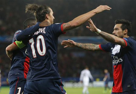 Paris St-Germain's Zlatan Ibrahimovic (L) celebrates with team mates after scoring his team's first goal during their Champions League socce