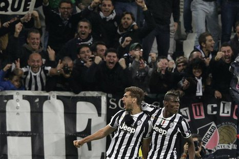Juventus Fernando Llorente (L) celebrates with his teammate Paul Pogba after scoring against Real Madrid during their Champions League socce