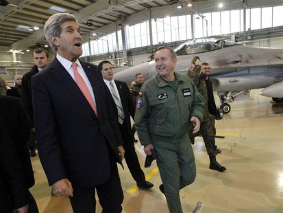 U.S. Secretary of State John Kerry (L) is pictured with the Polish Air Force's Lech Majewski in front of an F-16 during Kerry's visit to Las