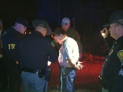 Photo 1 is Elmer Seeley (white shirt) as he is taken into custody.  photo courtesy of Indiana State Police