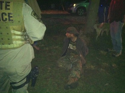 Photo 2 is John Abolt (dark clothing) as he is taken into custody. photo courtesy of Indiana State Police