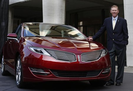 Alan Mulally, president and CEO of Ford Motor Company, stands next to the Lincoln MKZ mid-size sedan during a news conference in New York De