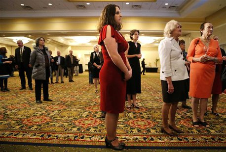 Amber Larsen (C) and fellow Republican supporters wait for poll numbers and election results at Virginia Republican gubernatorial nominee Ke
