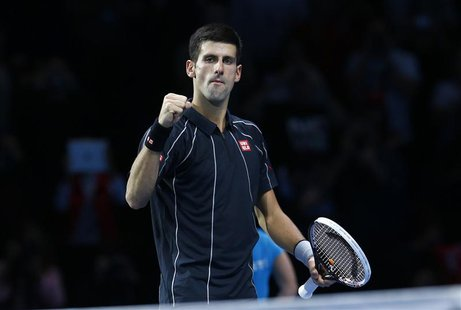 Novak Djokovic of Serbia celebrates after defeating Roger Federer of Switzerland in their men's singles tennis match at the ATP World Tour F