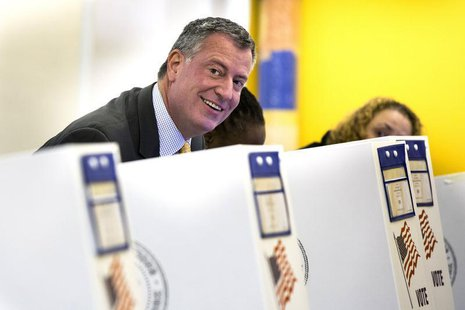 Democratic candidate for mayor of New York Bill de Blasio smiles while casting his vote in New York November 5, 2013. REUTERS/Lucas Jackson
