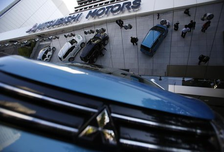 Mitsubishi Motors Corp's vehicles are seen at the company headquarters in Tokyo November 6, 2013. REUTERS/Issei Kato
