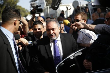 Former Israeli Foreign Minister Avigdor Lieberman, (C) steps out of a car as he arrives to hear the verdict in the corruption charges agains