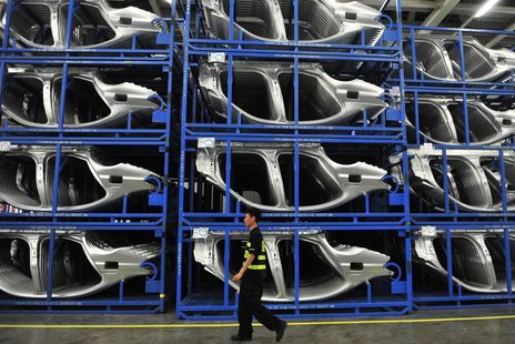 Security personnel walks inside a BMW factory in Shenyang, Liaoning province, July 6, 2013. REUTERS/Stringer