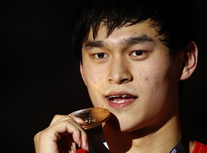 Gold medalist China's Sun Yang poses with his medal at the men's 1500m freestyle victory ceremony during the World Swimming Championships at