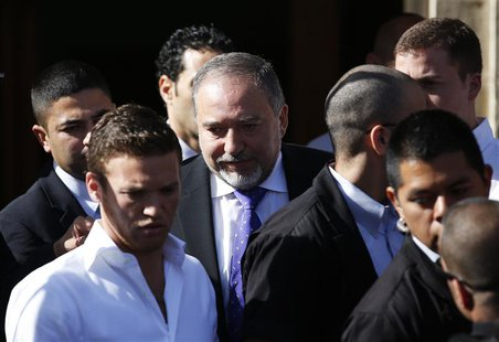 Former Israeli Foreign Minister Avigdor Lieberman (C) leaves the Magistrate Court in Jerusalem after hearing the verdict in the corruption c