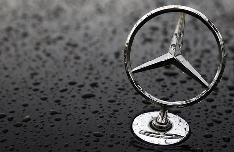 The emblem of German car manufacturer Mercedes-Benz, a subsidiary of Daimler AG, is pictured covered with raindrops at a parking lot in Hana
