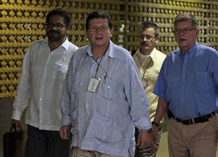 Negotiator for Colombia's Revolutionary Armed Forces of Colombia (FARC) rebel force Pablo Catatumbo (2nd L) arrives for peace talks with lea