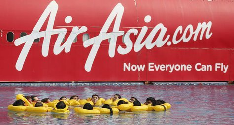 The logo of Malaysia's low-cost airline AirAsia Berhad is pictured on a structure as its staff undergo training at its academy in Sepang out