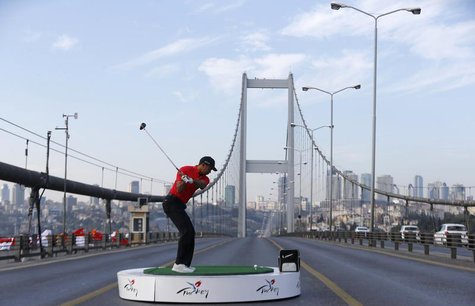 U.S. golfer Tiger Woods hits a shot during an event to promote the upcoming Turkish Airlines Open golf tournament, on the Bosphorus Bridge t