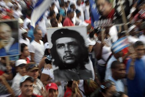 People carry an image of revolution leader Che Guevara during the May Day parade in Havana's Revolution Square May 1, 2013. REUTERS/Enrique