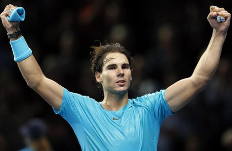 Rafael Nadal of Spain celebrates after winning his men's singles tennis match against Stanislas Wawrinka of Switzerland at the ATP World Tou
