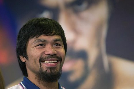 Boxer Manny Pacquiao of the Philippines smiles during a news conference in New York August 6, 2013. Pacquiao will fight Brandon Rios of the