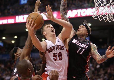 Nov 5, 2013; Toronto, Ontario, CAN; Toronto Raptors forward Tyler Hansbrough (50) is fouled as he goes to the basket against Miami Heat forw