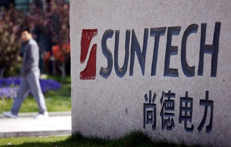 A man walks past Suntech Power Holdings' headquarters in Wuxi, Jiangsu province, in this March 21, 2013 file photo. REUTERS/Stringer/Files