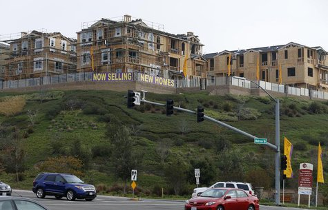 Vehicles travel near new houses which are under construction and for sale in San Marcos, California October 25, 2013. REUTERS/Mike Blake