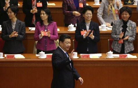 China's President Xi Jinping waves to delegates as he arrives for the opening ceremony of the 11th National Women's Congress at the Great Ha
