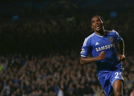 Chelsea's Samuel Eto'o celebrates after scoring a goal against FC Schalke 04 during their Champions League soccer match at Stamford Bridge i