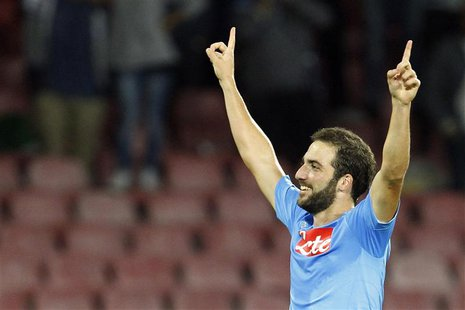 Napoli's Gonzalo Higuain celebrates after scoring against Olympique Marseille during their Champions League soccer match at San Paolo stadiu