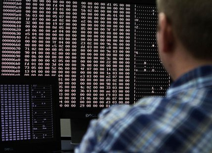 An analyst looks at code in the malware lab of a cyber security defense lab at the Idaho National Laboratory in Idaho Falls, Idaho September