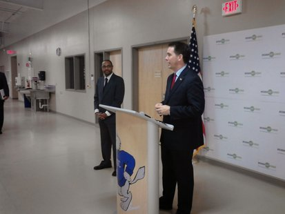 Governor Scott Walker and Department of Workforce Development Secretary Reggie Newson appear at NTC in Wausau, November 6, 2013