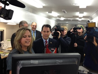 Governor Scott Walker views how he did after using the welding simulation booth inside LTC's Advanced Manufacturing Mobile Lab while in Sheboygan.