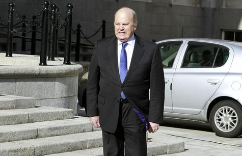 Ireland's Finance Minister Michael Noonan arrives at the Government Buildings before presenting his budget to parliament in Dublin October 1