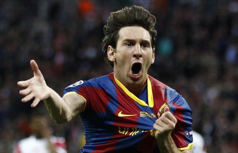 Barcelona's Lionel Messi celebrates after scoring against Manchester United during their Champions League final soccer match at Wembley Stad