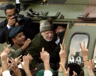 Palestinian President Yasser Arafat enters a helicopter as he leaves his compound in the West Bank city of Ramallah in this October 29, 2004