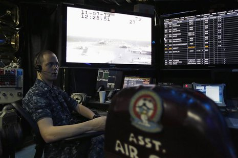 A U.S. Navy personnel works in the control room of the U.S. Navy aircraft carrier USS George Washington, during a tour of the ship in the So