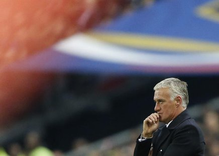 France's coach Didier Deschamps reacts during the 2014 World Cup qualifying soccer match against Finland at the Stade de France stadium in S