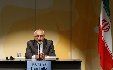 Iranian Foreign Minister Mohammad Javad Zarif addresses a news conference following nuclear negotiations with European Union's foreign polic