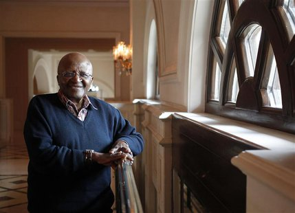 The former Anglican archbishop Desmond Tutu poses for a photograph after an interview with Reuters in New Delhi November 7, 2013. REUTERS/An