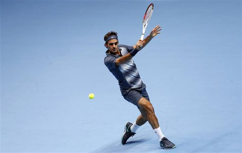 Roger Federer of Switzerland hits a return during his men's singles tennis match against Novak Djokovic of Serbia at the ATP World Tour Fina