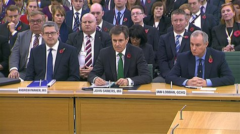 Andrew Parker the head of M15, John Sawers the head of M16 and Iain Lobban GCHQ director (L-R) are seen attending an Intelligence and Securi