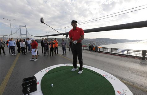 U.S. golfer Tiger Woods gets ready to hit a shot during an event to promote the upcoming Turkish Airlines Open golf tournament, on the Bosph