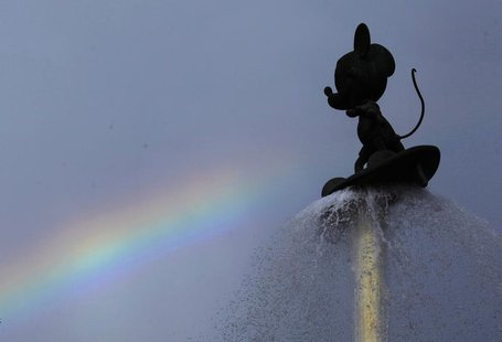A rainbow is seen behind a fountain featuring Mickey Mouse at the entrance of Hong Kong Disneyland July 13, 2012. REUTERS/Bobby Yip